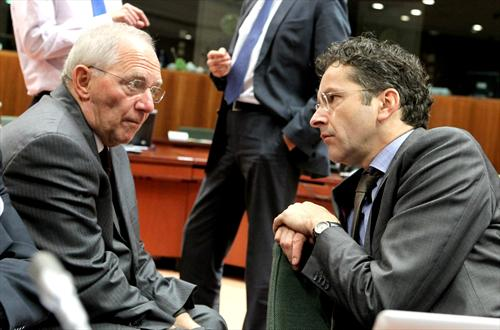 The German Minister of Finance, Wolfgang Schauble, speaks to Jeroen Dijsselbloem, President of Eurogroup at the Ecofin