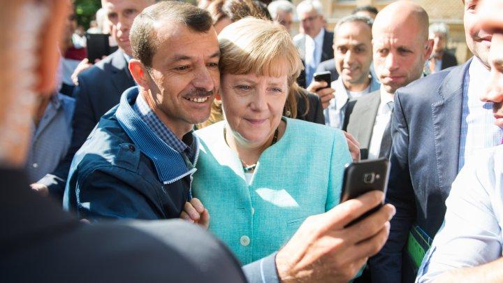 Merkel migranti