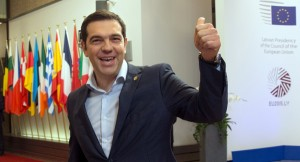 Greek Prime Minister Alexis Tsipras gestures as he leaves the EU