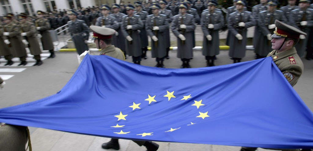 Bulgarian army honour guards carry the EU flag during an official ceremony at the Defence Ministry in Sofia