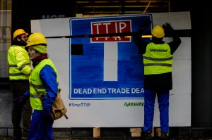 Greenpeace activists block secret TTIP talks in Brussels