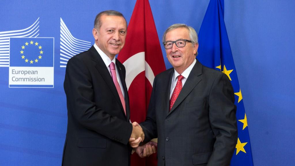 Handshake between Recep Tayyip Erdoğan, on the left, and Jean-C