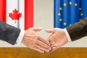 Representatives of Canada and the EU shake hands