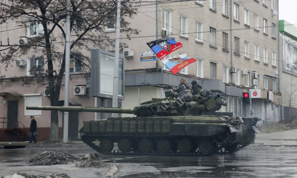 Pro-Russian separatists ride on a tank in Donetsk, eastern Ukraine