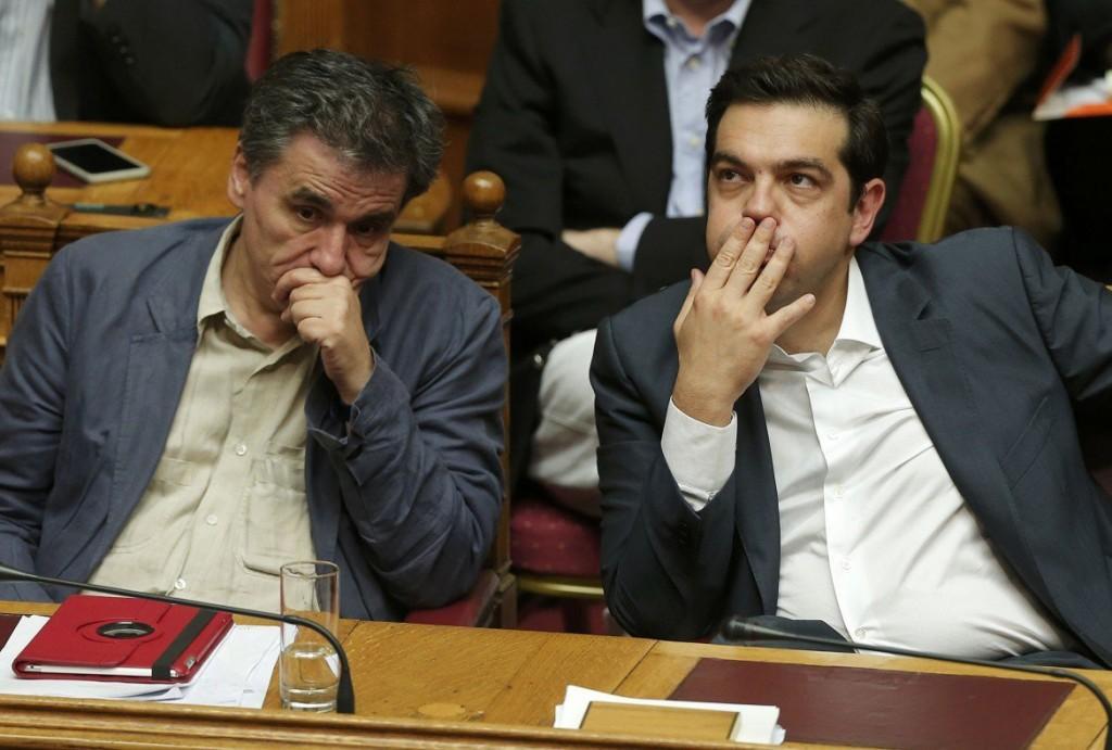 18desk1-riapertura-grecia-tsipras-sottide-tsakalotos-19