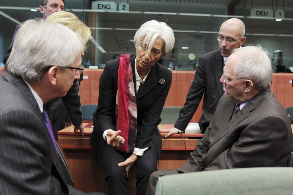 IMF President Lagarde talks to Eurozone finance ministers during an eurozone finance ministers' meeting in Brussels